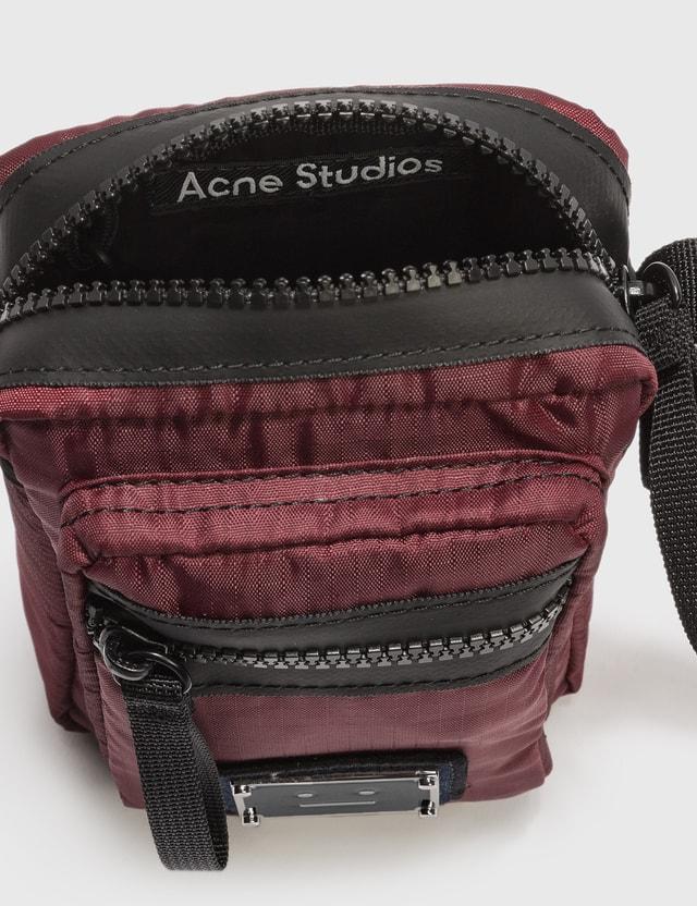 Acne Studios Arvel Plaque Face Crossbody Bags Red Men