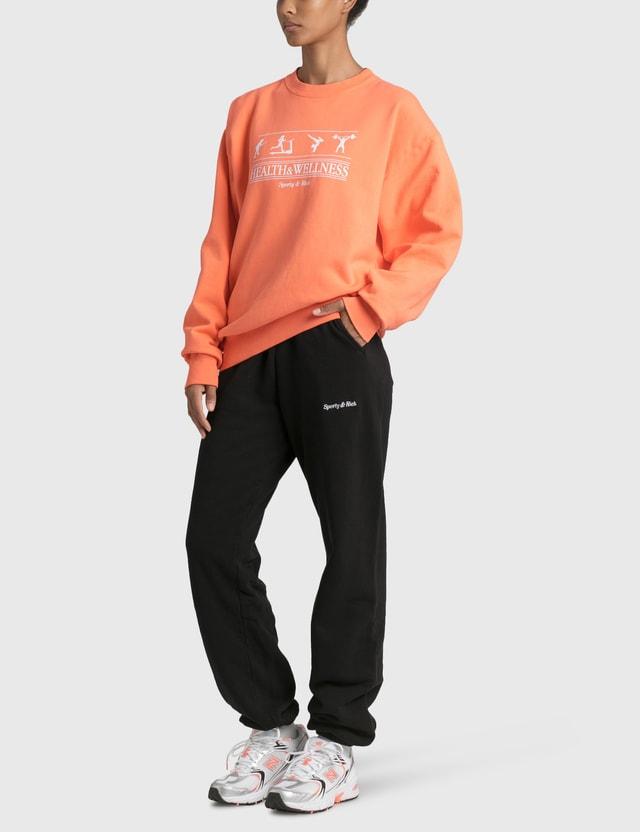 Sporty & Rich Health & Wellness Sweatshirt Guava Women