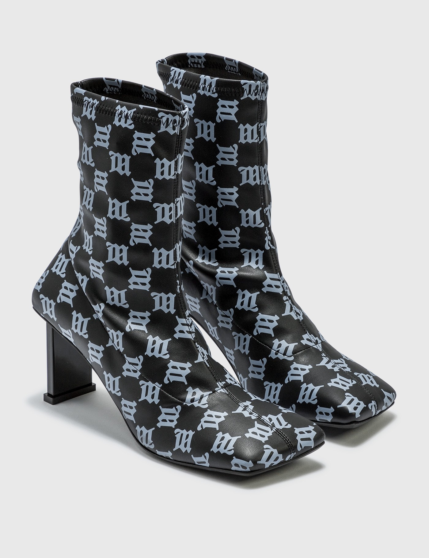 Misbhv SQUARE TOE MONOGRAM ANKLE BOOTS