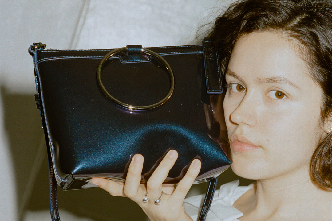 kara galaxy navy ring crossbody bag patent leather