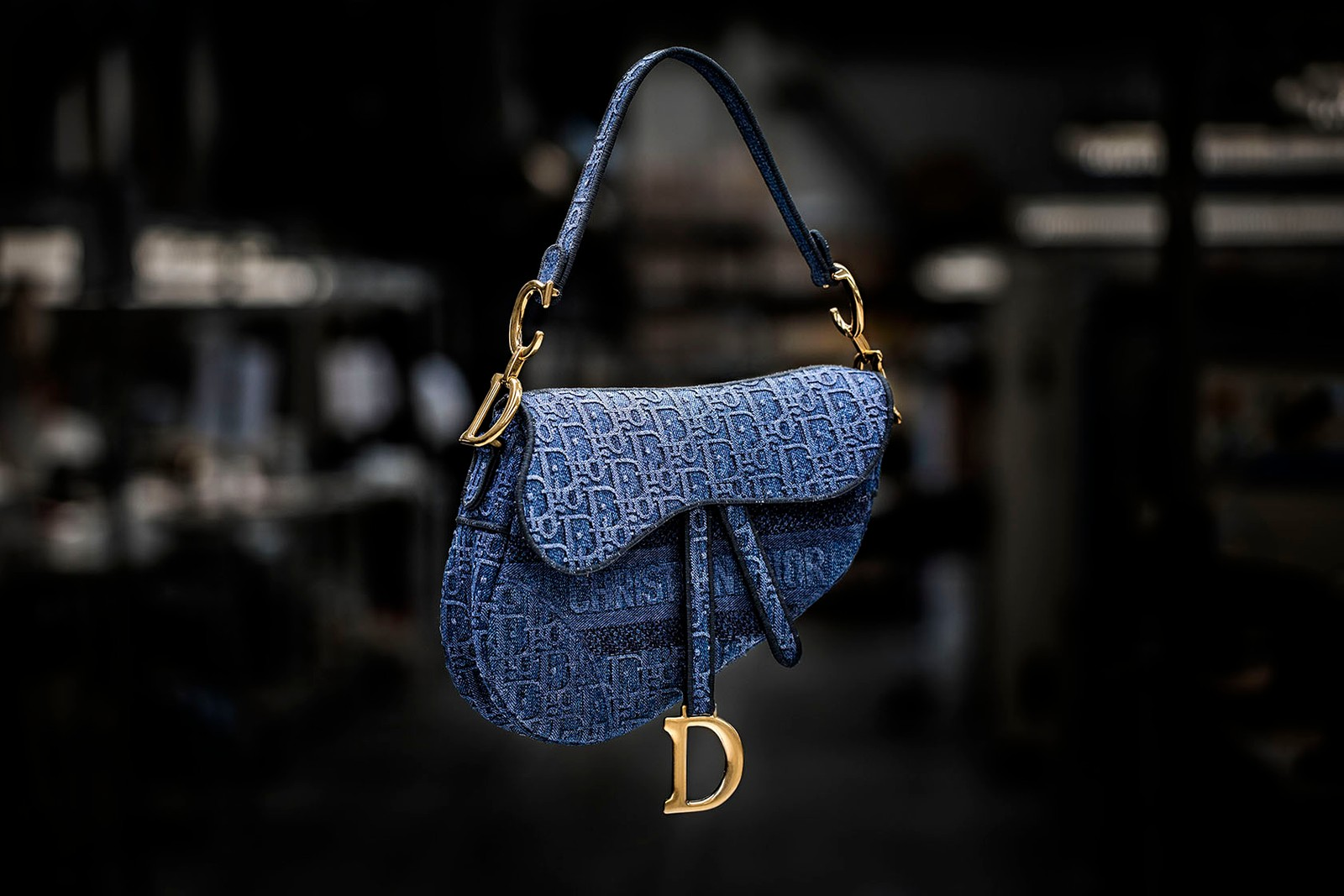 dior saddle bag how its made embroidered denim monogram blue stitching gold hardware