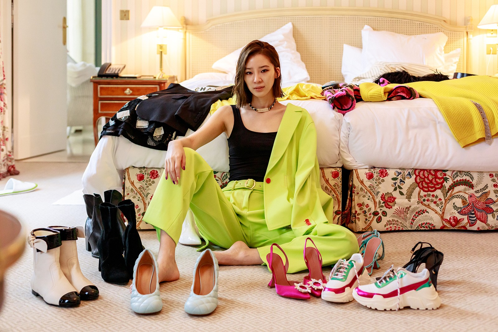 Irene Kim Street Style Influencer Celebrity Korean Model Pink Amina Muaddi High Heels Neon Green Sies Marjan Suit Hotel Room Bed Paris Fashion Week Spring Summer 2020 Hair