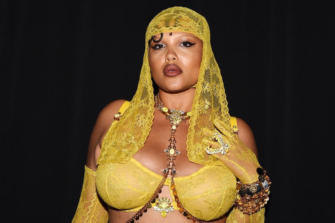 Rihanna Savage X Fenty Show New York Fashion Week Spring Summer 2020 Dress Black Maison Margiela Red Lip Earrings
