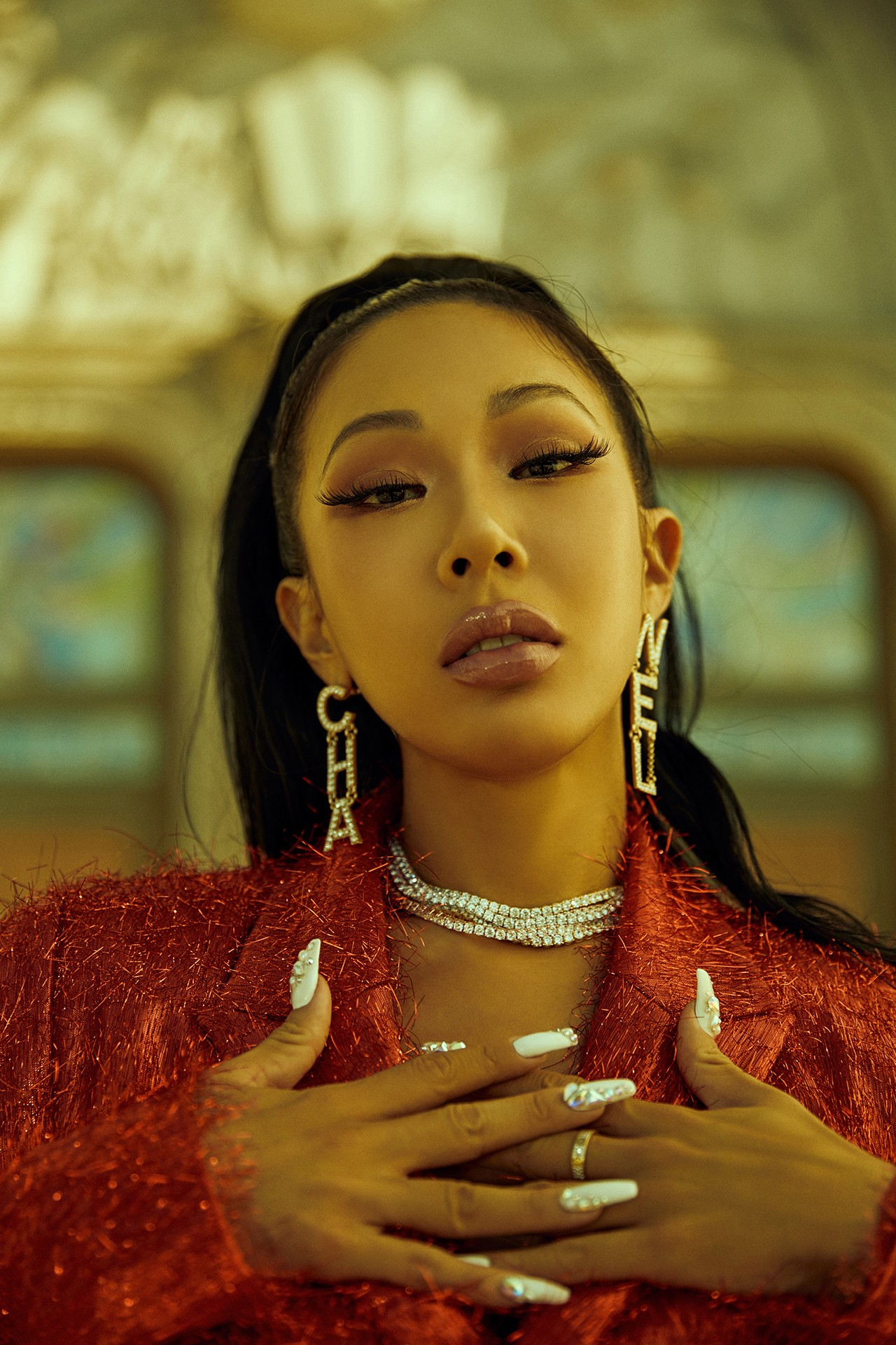Jessi Jessica H.O Korean American Rapper Hip Hop Music Artist P NATION Chanel Logo Earrings Red Jacket Blazer White Nails