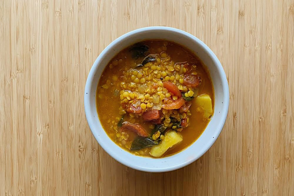 Healthy Food Ingredients Asparagus Vegetables Onion Red Lentils Ginger Garlic Beans Kitchen Table Chopping Board Wood