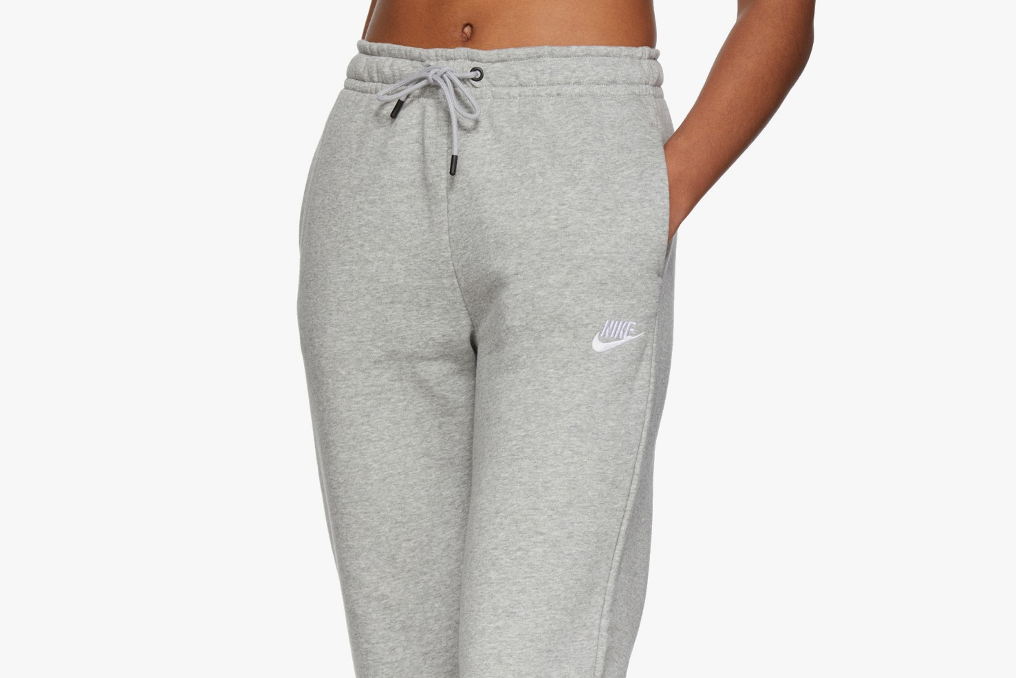 sweatsuit sweater sweatpants grey nike logo swoosh socks sofa couch leather white