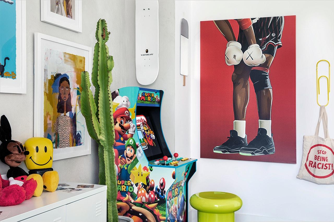 Victoria Adesanmi Home Office Culver City Los Angeles Loft Streetwear Pop Culture Kaws Seasame Street Plush Toy Sean Brown Jay-Z Rug Art Books Posters Interior Design Cactus