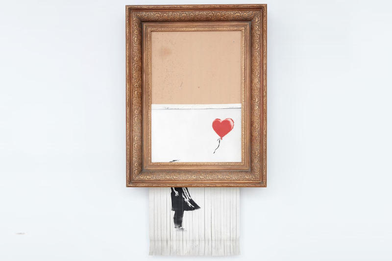 Banksy 經典《Girl With a Balloon》自毀後正式更名並成功售出