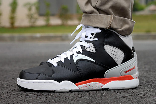403bb16a388 Available now from Reebok is the hybrid Classic Jam in a new black orange  colorway. The shoe