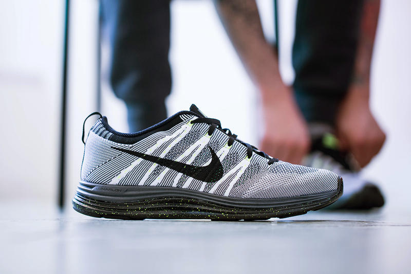 916e3ff9abb4 Next up for the Nike Flyknit Lunar 1+ is this white black dark grey-volt  colorway. This latest