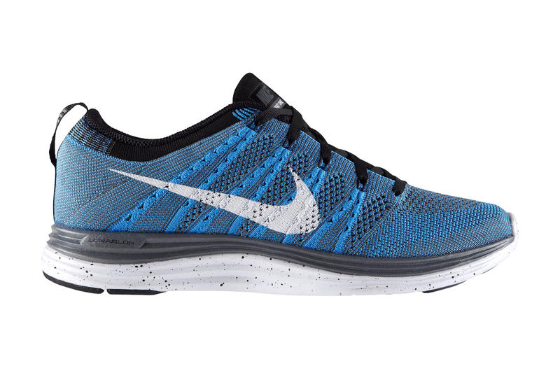 sports shoes b69eb bd86a Available now from Nike is the Flyknit Lunar 1+ in this blue glowwhite-black-dark  grey colorway.
