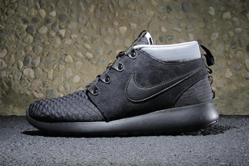 760330b091ee Nike s winterized Roshe Run Sneakerboot receives a black and silver  makeover for the fall season.