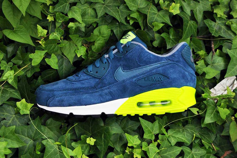 hot sale online 71273 f4a24 From Nike s spring collection comes this navy volt colorway of the Air Max  90 PRM. This colorway