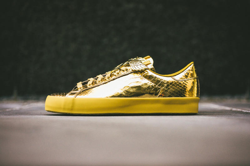 5f9f2a33c6df The classic Rod Laver gets the bold Jeremy Scott treatment with a metallic  gold release this spring