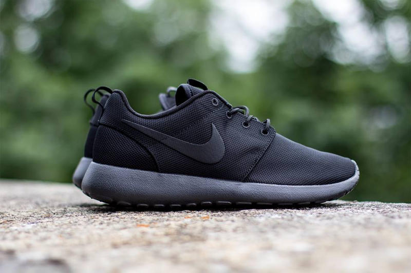 new concept f91d3 0a50a Nike Sportswears fan-favorite Roshe Run gets a tried-and-true  black-on-black makeover with the