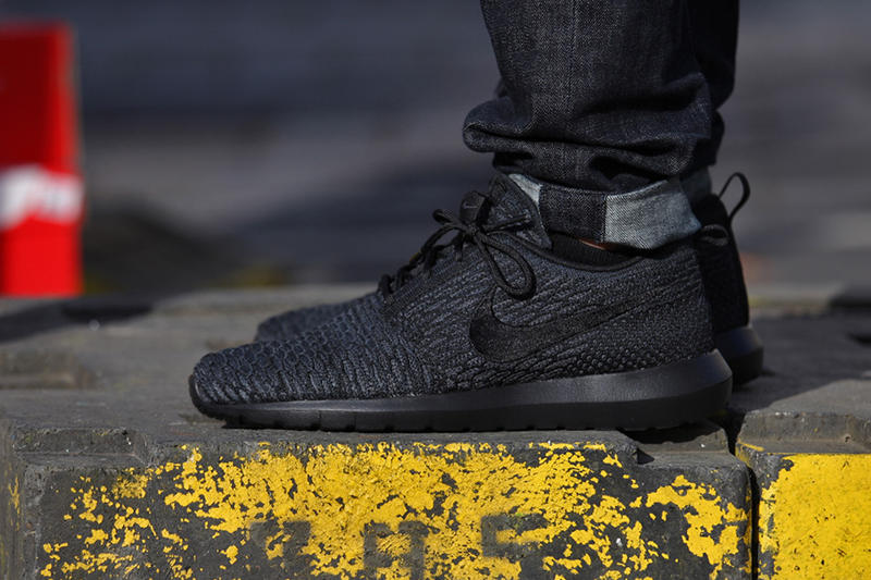 d7f9615bd829 In line with the recent rise of completely black colorways comes the Nike  Flyknit Roshe Run also in