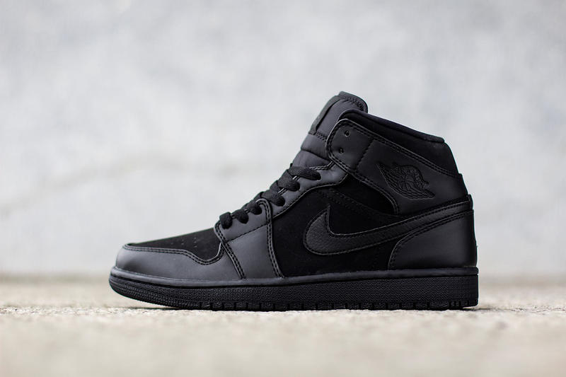 44073f63cbc8 Hot on the heels of the  Tropical Teal  colorway is the Air Jordan 1 mid-top  in  Triple Black.  The