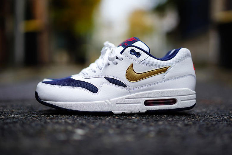 """official photos 7740b 7de63 Nike adds to its iconic Air Max 1 line with a new """"Olympic"""" iteration.  Featuring a premium tumbled"""