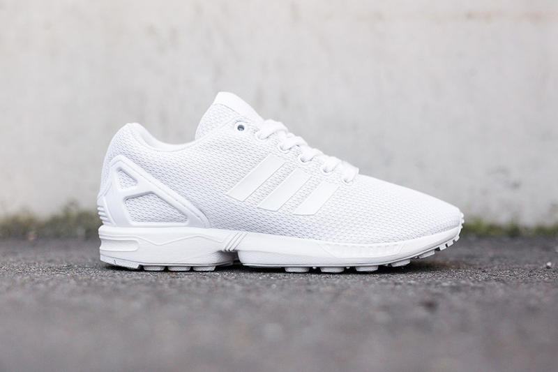 "adidas Originals has released a brand new pair of its ZX Flux runner model  dubbed ""All White a49135bd7e08"