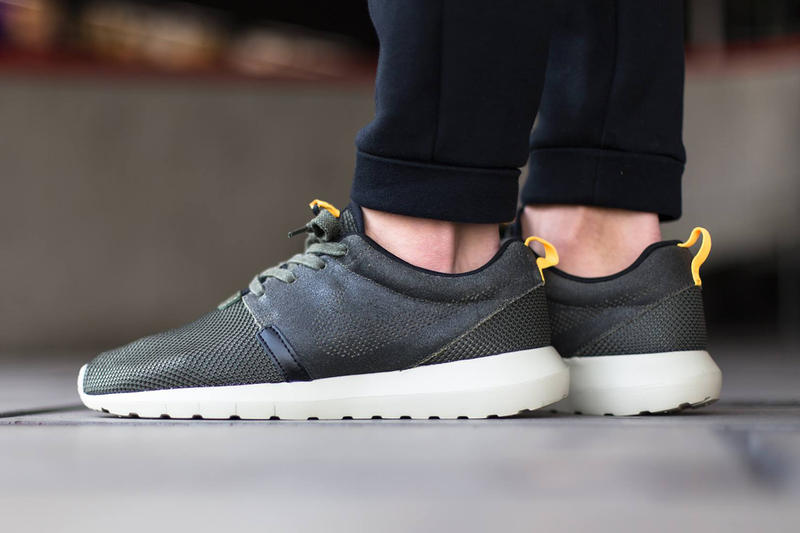 "The premium Nike Roshe Run NM FB gets a new colorway for spring in ""Cargo  Khaki."" Washed over in a dc6f15335"