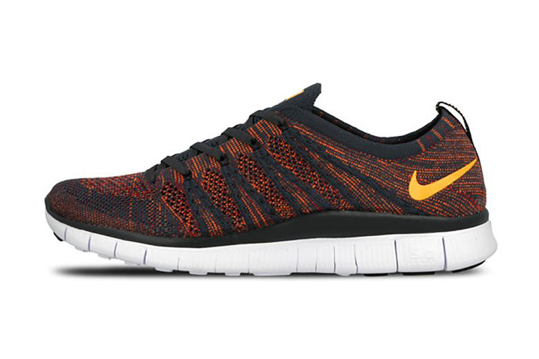"""78901ca9859d ... Anthracite Laser Orange-Gym Red-Total Orange. Nike follows its  """"Grape""""-like colorway with a fiery take on the Free Flyknit NSW."""