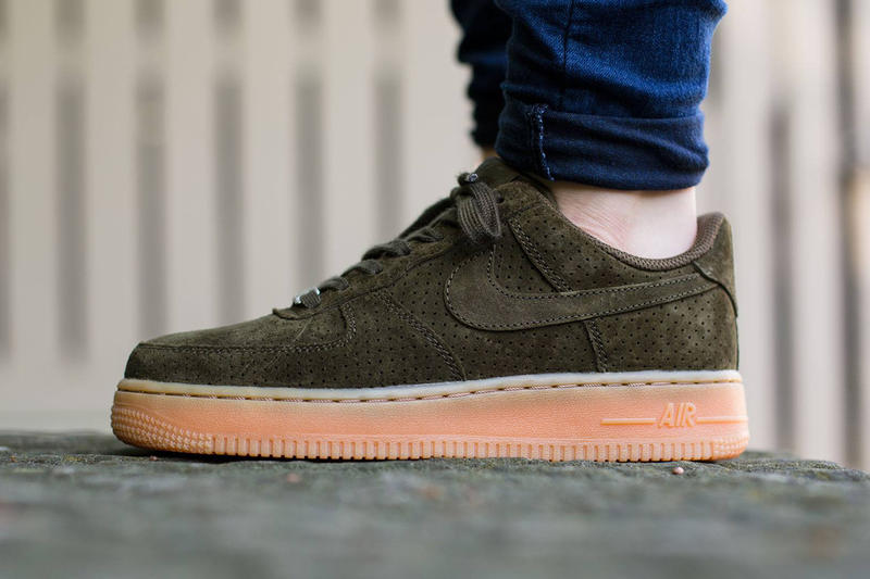 41ef186929f5 Nike combines dark suede and a gum sole in this winning formula for the Air  Force 1 Low.