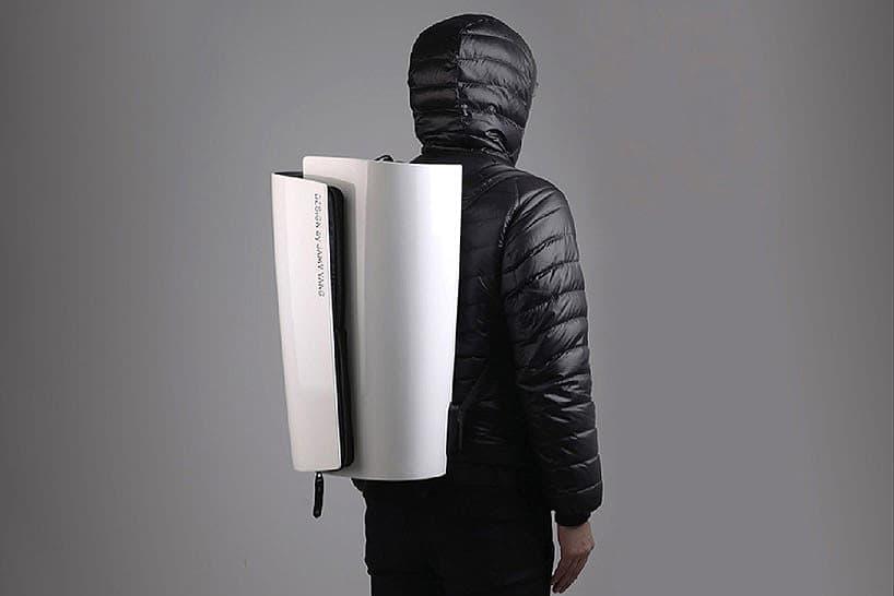Tumi Swiss Roll Hard Shell Backpack by Jamy Yang