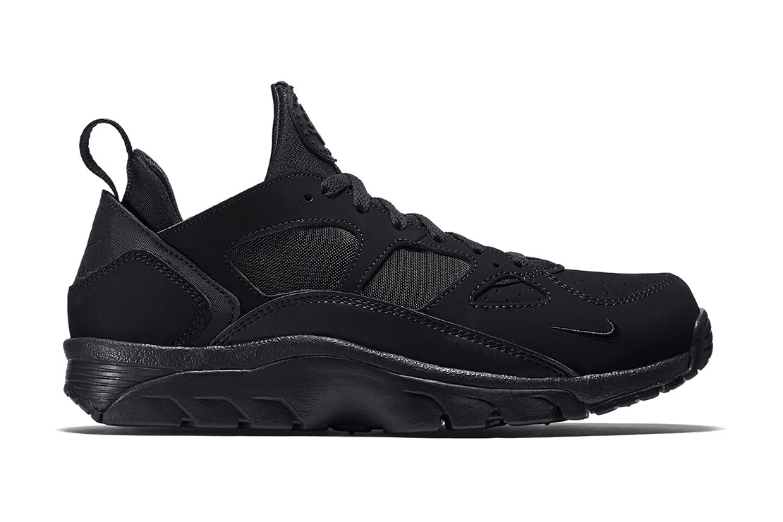 The low,top Air Trainer Huarache gets the all,black treatment.