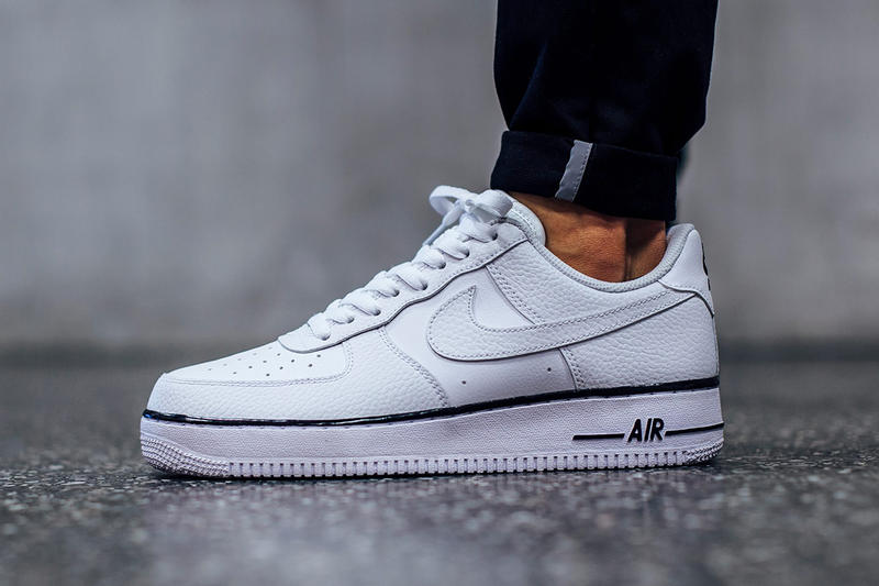 buy online c440a 1fb4e Nike s Latest White Air Force 1 Sports a Dash of Black. And a star-studded  tongue to boot.