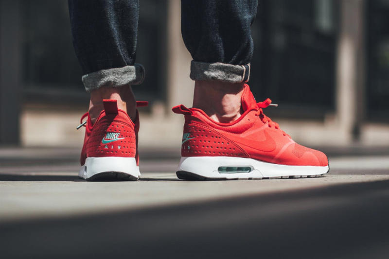 e1d02e5dba8 Nike Air Max Tavas Drops in Fiery Action Red. Set to sizzle this summer  season. 1 of 3. 2 of 3. 3 of 3