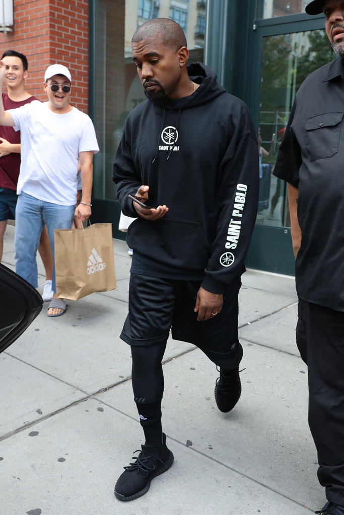 cf1c2db3c4ff Kanye West Wears Unreleased Yeezy Boosts and Saint Pablo Tour Merch ...