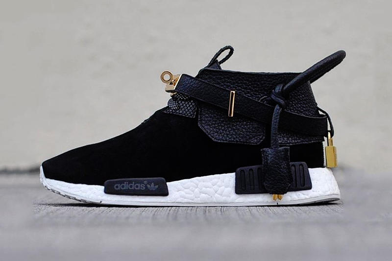 The Remade Creates a Pair of Hermès x adidas NMD originals french luxury house custom made black gold lock