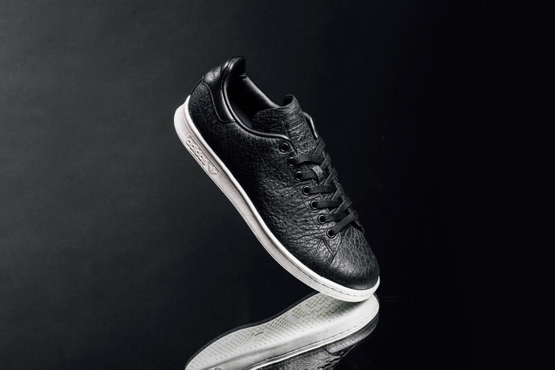 fec791b7246ff2 adidas Originals Drops a Tumbled Leather Stan Smith. A clean black and white  colorway allows the construction to shine.