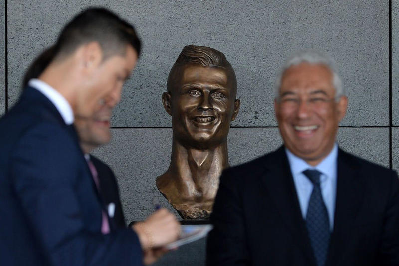 cristiano ronaldo madeira portugal international airport bronze bust statue face football soccer twitter