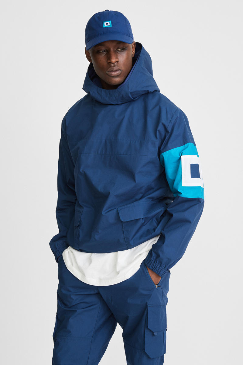 KITH x Aimé Leon Dore Mykonos Collaboration Navy Nammos Pullover Sailing Jacket Front Evil Eye Cap Front