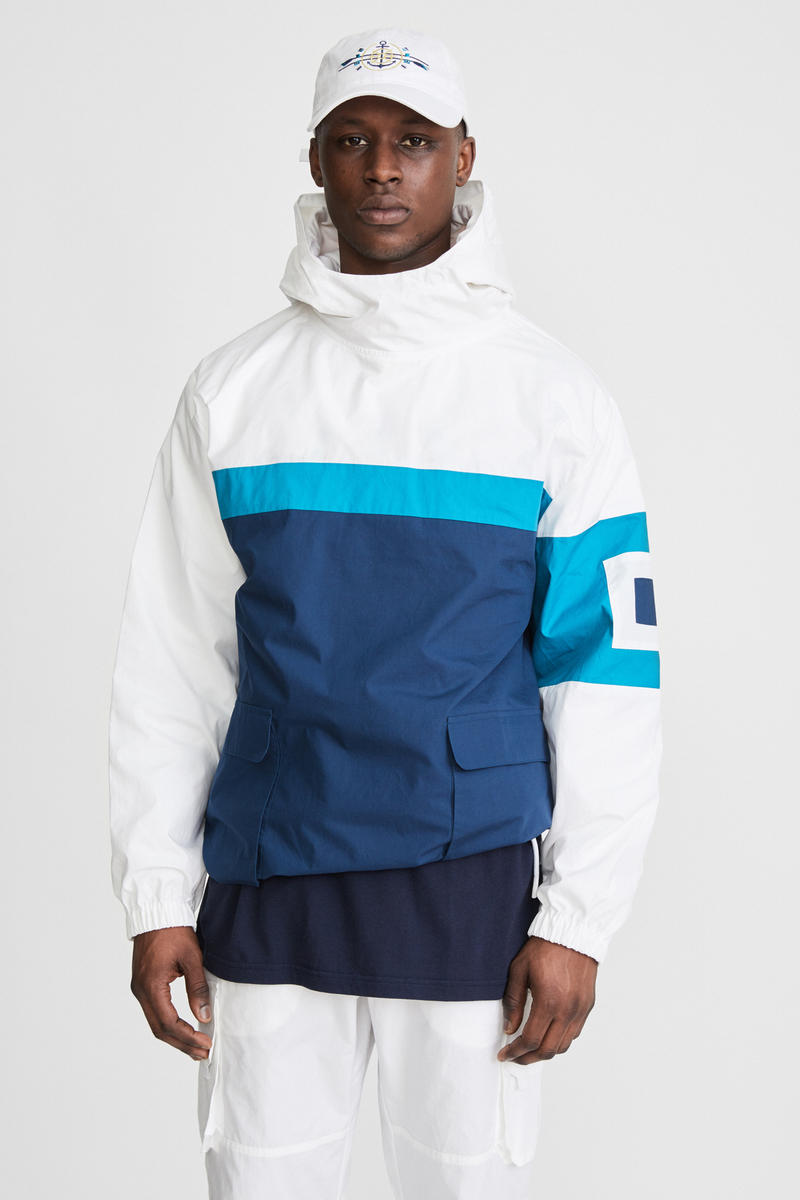 KITH x Aimé Leon Dore Mykonos Collaboration White Nammos Pullover Sailing Jacket Front White Anchor Logo Cap Front
