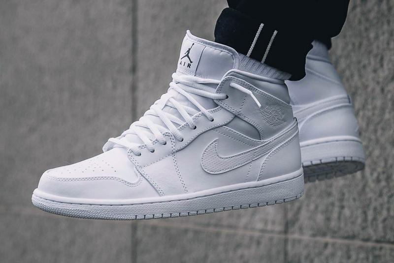 outlet store 9c8e9 24f24 The Air Jordan 1 Mid Goes Triple White