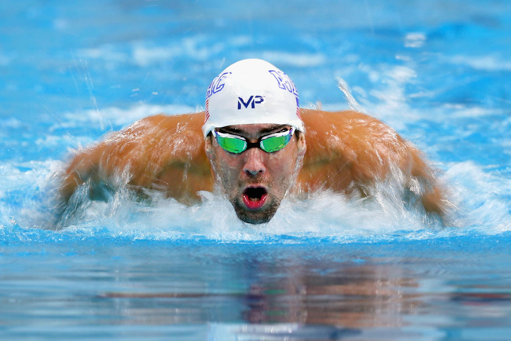 michael phelps great white shark race vs versus discovery channel week gold swim swimming faster