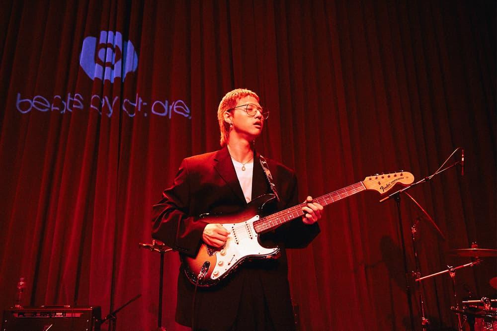 Beats by Dre Luke Wood Hyukoh Interview frontman Hyuk playing guitar red curtain