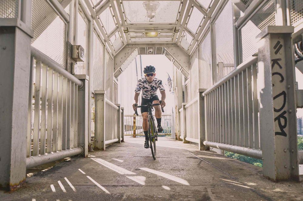 VSCO x Oakley Prizm Sport Lens biking on bridge