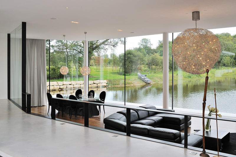 AUM Architects Architecture Design White Snake House France Lake Top White Concrete Glass Swimming Pool Gym