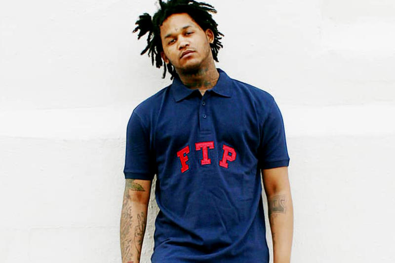 Fredo Santana is wearing a blue t-shirt