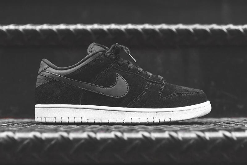 6b5e6a788e3c A clean colorway lets the materials do the talking. Nike Dunk Low Premium  Black Suede Leather White ...