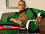 Gucci Reimagines Vibrant Track Suits and Leather Waist Bags in Its Cruise 2018 Collection