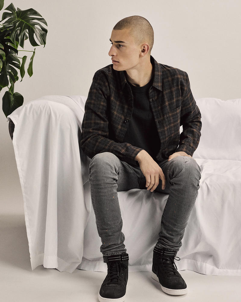 John Elliott Launches Black Friday Collection Thanksgiving Capsule Collection varsity jacket stadium plaid flannels cashmere beanie cold weather promotion menswear