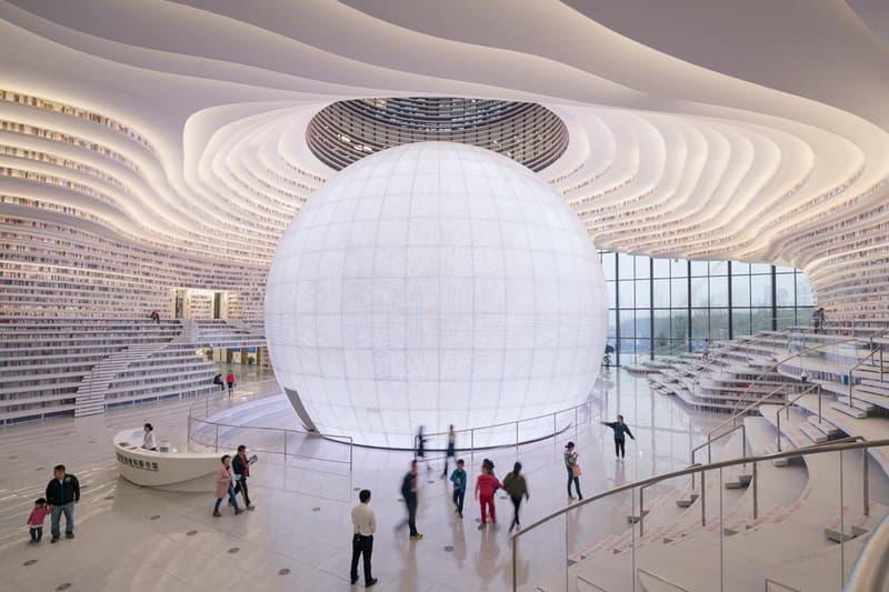 Tianjin Binhai Library China Design By MVRDV develop GMP architekten architecture architectures sphere ball white bgass urban planning and design institute TUPDI cave books bookshelves bookshelf orb eye