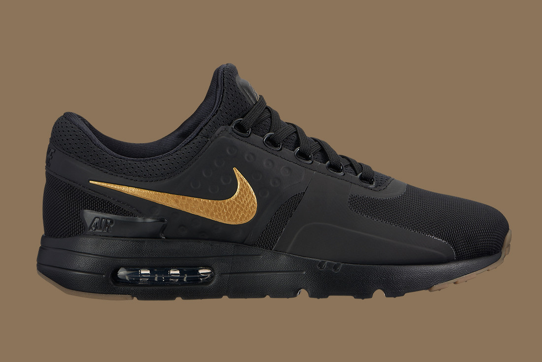 gold and black nikes