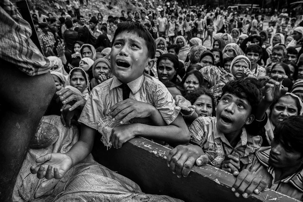 Time Magazine Top 10 Photos of 2017 Harvest Festival Tragedy Bangladesh Starvation Polar Bear Artic Conservation