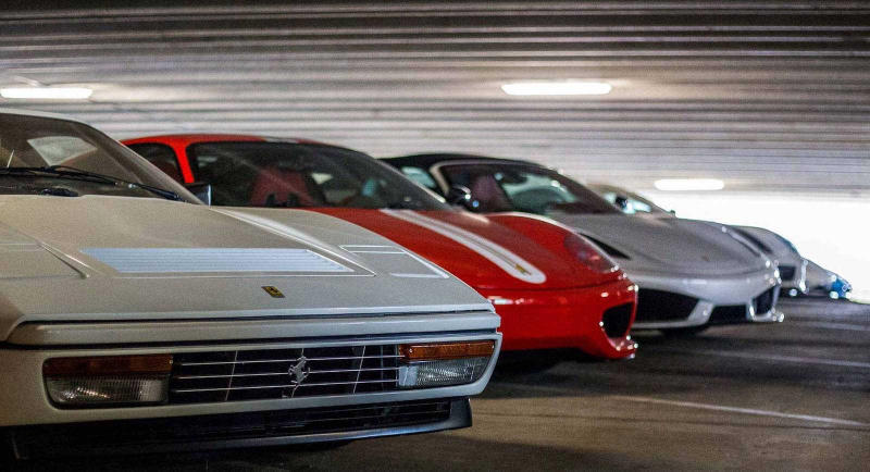 Supercars Collecting Dust Parking Garage Alfa Romeo Aston Martin Chevrolet Chrysler Prowler Ferrari Ford GT Mustang Jaguar Lamborghini Aventador Porsche