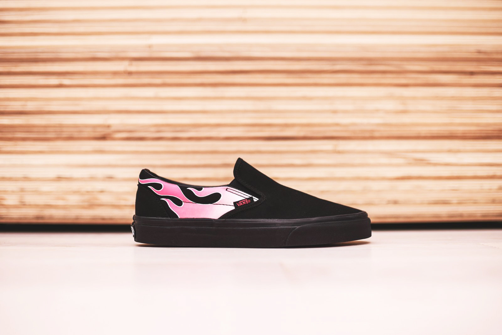 pink vans with flame